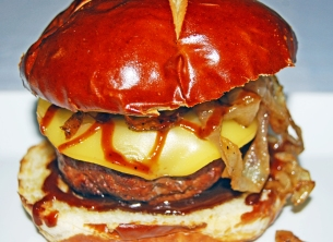 Guinness smoked Gouda burger with caramelized onions and Guinness burger sauce
